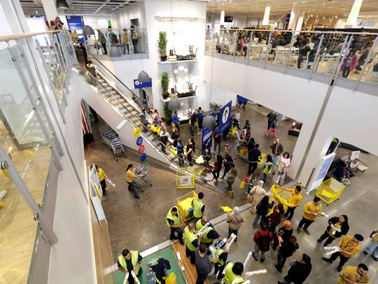 People browse inside a new Ikea store in Burbank, Calif.