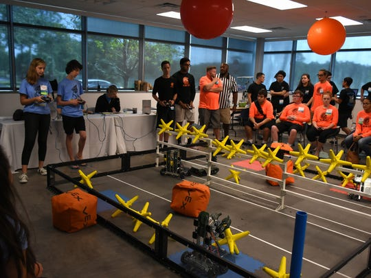 Madison Szittai of Naples High School, left, controls her team's entry in the robotics competition. On Saturday, May 13, over 300 students from every public school in Collier County competed in the STEAM Conference at the FSW campus in East Naples.