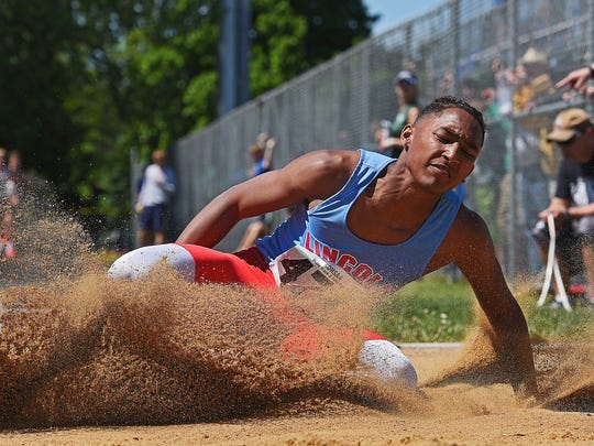 Lincoln's Malik Redd competes in the boys long jump during the South Dakota Class AA State Track & Field Meet Friday, May 26, 2017, at the Brandon Valley High School in Brandon, S.D.