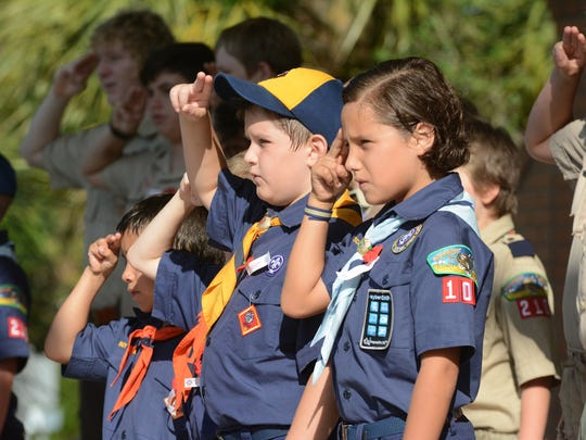 Boy Scouts and Cub Scouts join dignitaries onstage for the Pledge of Allegiance. The City of Bonita Springs commemorated Memorial Day with a ceremony Monday morning at Riverside Park.