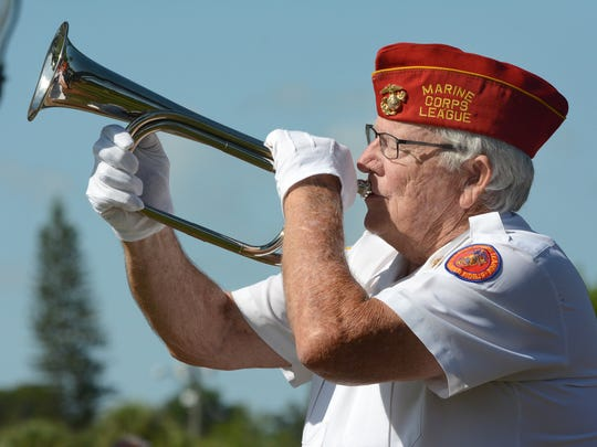 Jerry Van Hecke of the Marine Corps League plays taps. The City of Bonita Springs commemorated Memorial Day with a ceremony Monday morning at Riverside Park.
