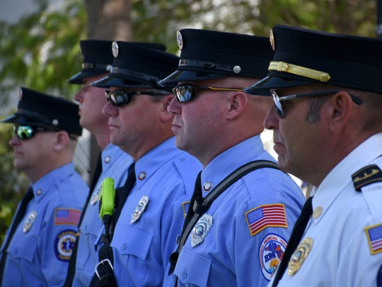 First responders stand at attention. The City of Bonita Springs commemorated Memorial Day with a ceremony Monday morning at Riverside Park.