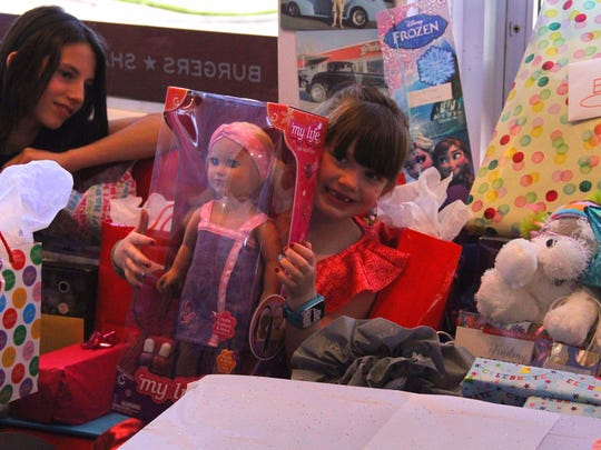 Six-year-old Evan Rose opens gifts during her birthday
