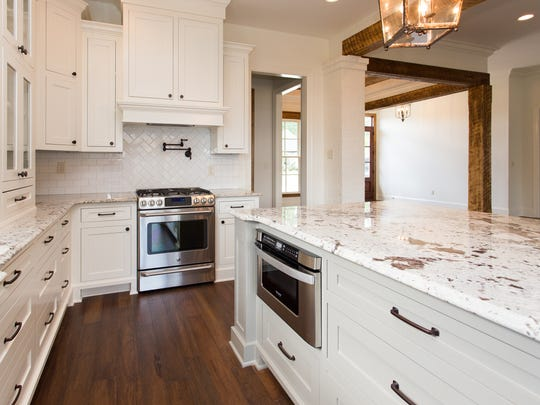 Stainless-steel GE appliances throughout the kitchen