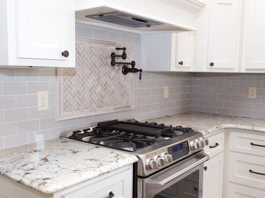 Gorgeous granite countertops and stainless-steel appliances are in the kitchen