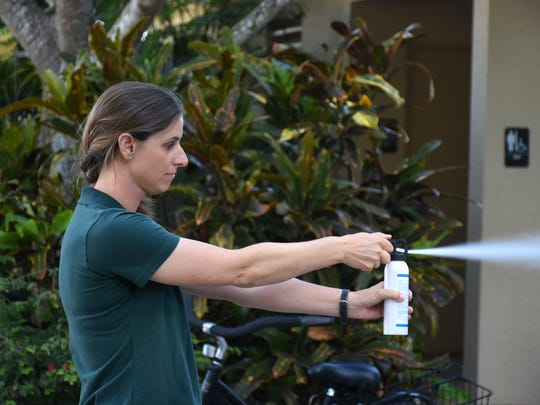 Biologist Wynlyn McBride demonstrates bear spray.