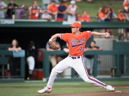 Clemson's Charlie Barnes (23) throws a pitch during a NCAA regional baseball game against Vanderbilt at Doug Kingsmore Stadium on Saturday, June 3, 2017.