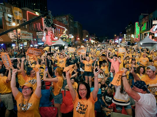 Predators fans on Lower Broadway celebrate after Nashville