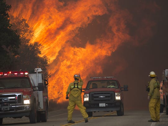 David McNew,  Getty Images SANTA CLARITA, CA - JULY 24: Firefighters are forced to retreat as flame close in on them in Placerita Canyon at the Sand Fire on July 24, 2016 in Santa Clarita, California. Firefighters in California and across the country rely on timely and consistent weather data to understand fire behavior.