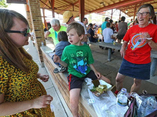 "Oliver Henike, 7, ""ate everything"" of the tamales, jerk chicken, Cuban pork and more ordered by Beth Henike (left), Shirley Henike and other family members during a stop of the Food Truck Tour at the West Allis Farmers Market on June 7."