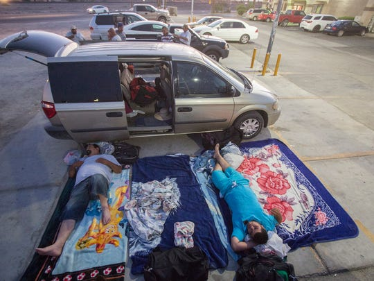 From left, Valentin Zavala and his nephew Alberto Zavala Jr. get ready to sleep on the ground next to their vehicle in Mecca on June 9, 2017. The Zavalas are a family of half a dozen family farm workers that were able to rent housing at the San Filipito complex in Thermal in 2016 but the housing, which was managed by DAYS, closed for this current year, causing further lack of housing for temporary farmworkers who come to the valley to pick grapes.