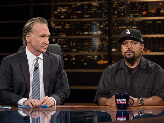 In this image released by HBO, host Bill Maher, left,