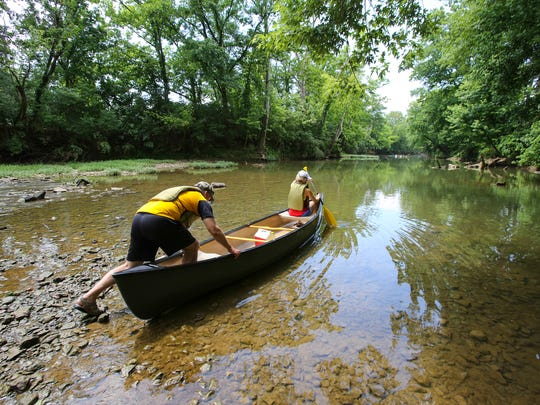 Jeff Sherwood and his daughter, Megan Sherwood, prepare to paddle on Floyds Fork on Monday afternoon. June 13, 2017