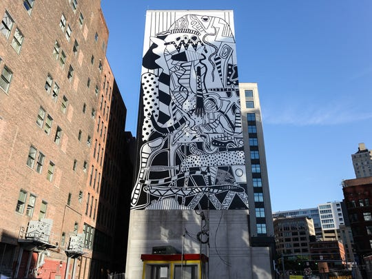 """Still Searching"", an exhibit spanning the 70-year career of Detroit-based multimedia artist Charles McGee, drew hundreds to 1505 Woodward Ave. coinciding with the unveiling of his large-scale, outdoor mural ""Unity"" located directly adjacent to the exhibition."