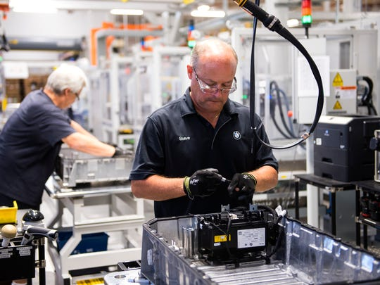 BMW associates build batteries for plug-in electric vehicles at the automaker's high-voltage battery line in Spartanburg on Wednesday, June 14, 2017.