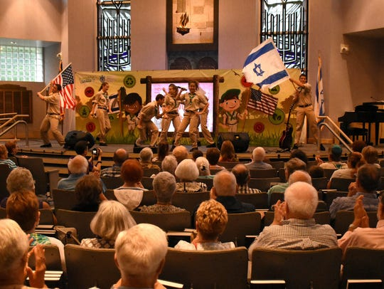 For the finale at Temple Shalom, the troupe waves the
