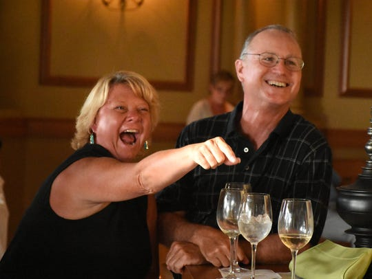 """File: Elaine Orr and husband Lynn celebrate winning the dinner at a previous """"Glory of the Grape."""""""