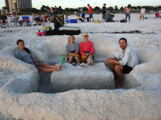 "Scott, Ginger, Grace and Cindy Roloff won an award for their innovative ""sand castle."" Marco Island celebrated Independence Day at the beach on July 4, with beach games, fireworks, and a variety of weather."