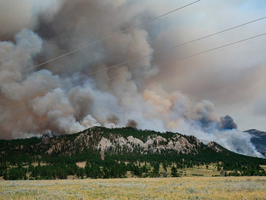 A wildfire burns south of the Fort Belknap Indian Reservation in north-central Montana in 2017.