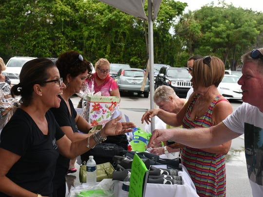La Tavola co-owner Lisa Verdi greets a visitor. La Tavola restaurant hosted a fundraiser on Sunday for baby Cash, son of Marco Island firefighter Nick Macchiarolo and his wife Gabriella, to help with his considerable medical expenses.