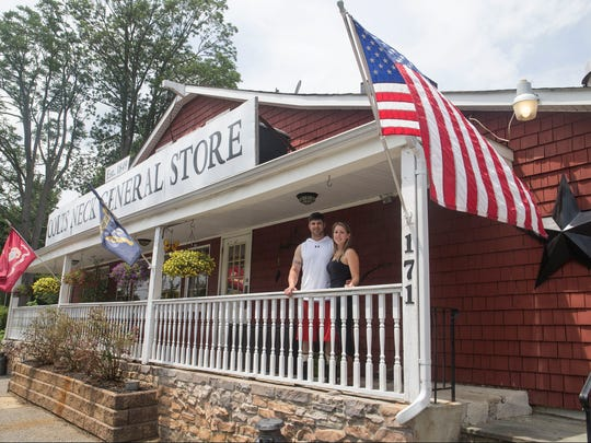 Store owner Mary Dwulet stands on the front porch with her husband Mike Pahira. The Colts Neck General Store, a deli and gift shop housed in a historic 168-year-old building has been purchased by former employee Mary Dwulet.