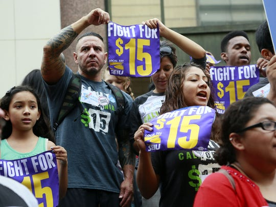 Workers hold a rally in support of a Los Angeles County Board of Supervisors' proposed minimum wage ordinance, in Los Angeles, on Tuesday, July 21, 2015.