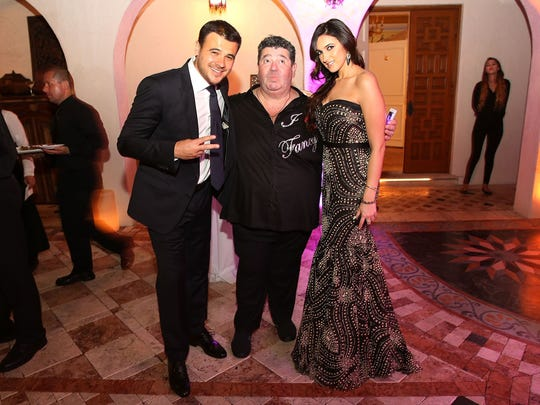 Emin Agalarov, Rob Goldstone and Sheila Agalarova attend a New Year's Eve And Birthday Party in Miami Beach in December 2014.
