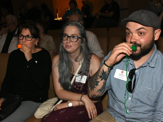 Mike Milewski blows his air blaster to applaud. Winners of the 19th annual Best of Bonita awards were celebrated Thursday evening in a gala presentation at the Center for the Performing Arts in Bonita Springs.