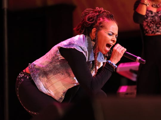 Detroit-based poet Jessica Care Moore performs with the Don Was Detroit All-Star Revue during the 25th annual Concert of Colors.