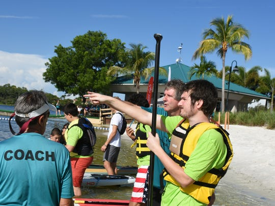 Coaches point out the course to the athletes pre-race. Collier County hosted the Special Olympics Florida Area 9 Standup Paddle (SUP) Games on Saturday, July 15 at Sugden Regional Park in Naples.