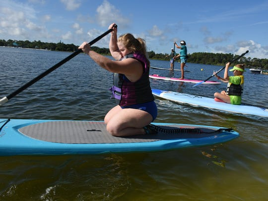 An athlete named Leanne heads out on her race. Collier County hosted the Special Olympics Florida Area 9 Standup Paddle (SUP) Games on Saturday, July 15 at Sugden Regional Park in Naples.