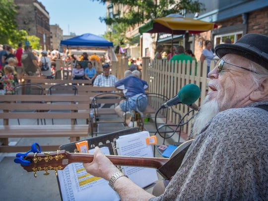 Michael Murphy performs outside the Magnet during the Farmer's Market.at the third Main Street Music Festival in 2015. This year's festival runs July 26 through 30.