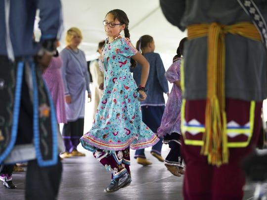 Kayleen Block dances with Iroquois Social Dancers at