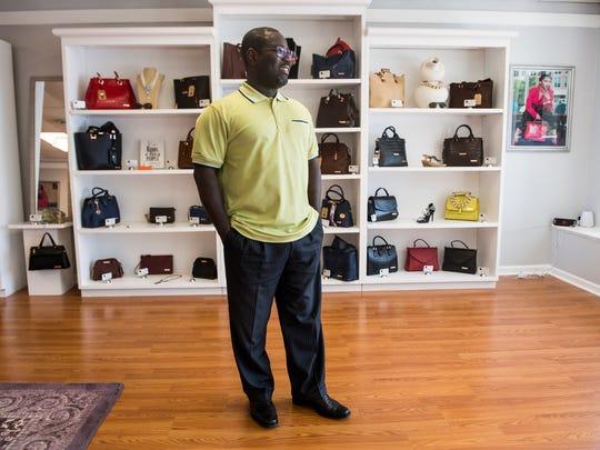 Jon Kane, a handbag designer, poses for a portrait