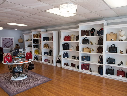 Various handbags are on display at Kane Collections