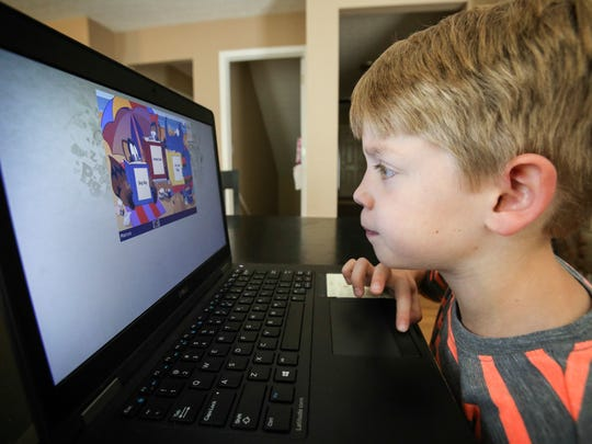 Marcus McLean, 5, works on a web-based instructional