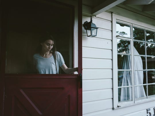 Rooney Mara (left) mourns as Casey Affleck (under the