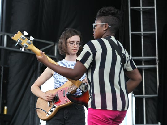 Indie rock artist Stef Chura, left, performs with her band during the 2017 Mo Pop Festival at West Riverfront Park in Detroit.