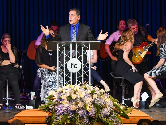Todd Menard addresses Friends and family as they say goodbye to D.L. Menard during Funeral Services held at Family Life Church . Monday, July 31, 2017.