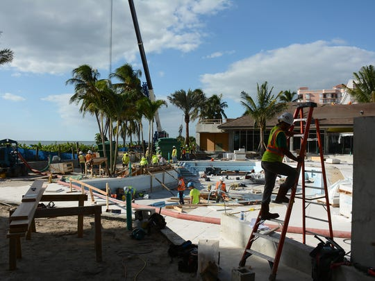Equipment is set into place behind the lobby, where the entire pool area is being revamped. The Marco Island Hilton has been closed since June 1 as the hotel undergoes a $40 million renovation.