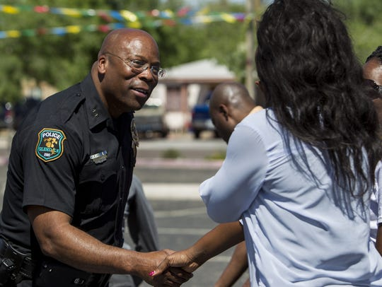 Glendale police Cmdr. Andre Anderson greets people