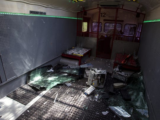 Smashed objects are shown on the Insanity AZ bus on Aug. 4, 2017, in Phoenix.