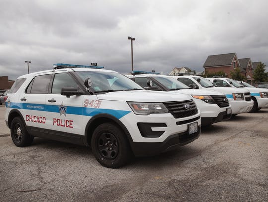 Ford Explorer-based Police Interceptors sit in a police