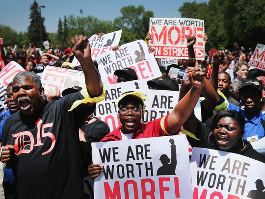 Fast food workers and activists demonstrate outside