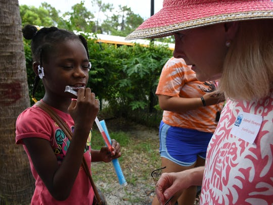Fourth grade teacher Debbie Thompson talks with Dorena Charles, 9. Teachers from Manatee Middle and Manatee Elementary boarded buses Wednesday afternoon and visited their soon-to-be students  at four Habitat for Humanity communities.