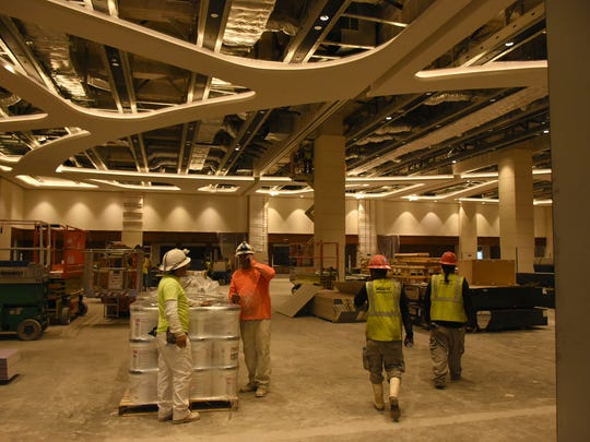 Workers ply their trades in the Banyan Ballroom. Work continues at Marco's JW Marriott hotel, with final completion pushed back by enhancements to the new wing.