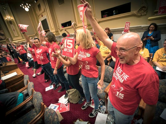 Supporters of the $15 minimum wage increase celebrate