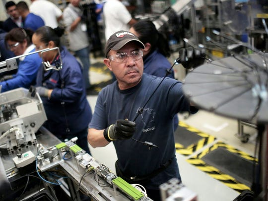 At work in the auto parts production line in the Bosch