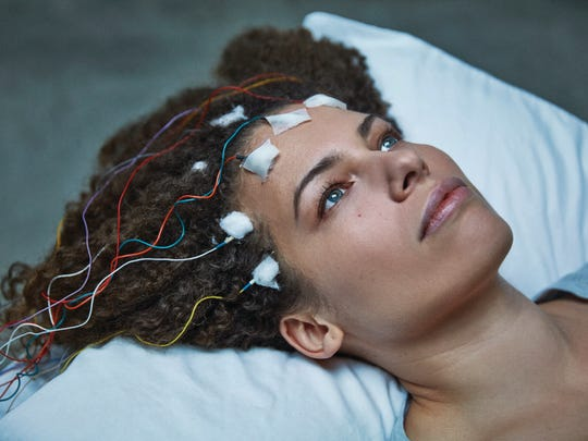 "Jennifer Brea sets out to get to the bottom of a malady that's stopped her in her tracks in the documentary ""Unrest."""