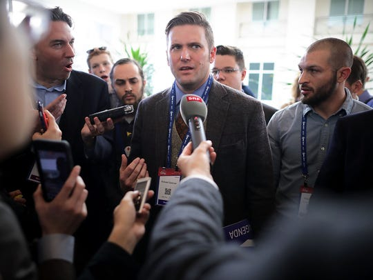 """Self-proclaimed """"alt-right"""" leader Richard Spencer speaking to reporters at the annual CPAC Event In National Harbor, Maryland on Feb. 24, 2017."""